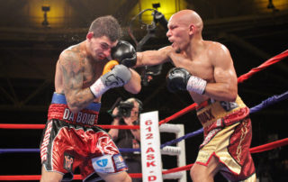 Caleb Truax hammering on Don George, from June 21, 2013. Photo credit: Jesse Kelley/Seconds Out Promotions